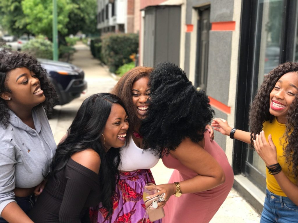 Five beautiful women having fun, laughing so much they cant stand straight