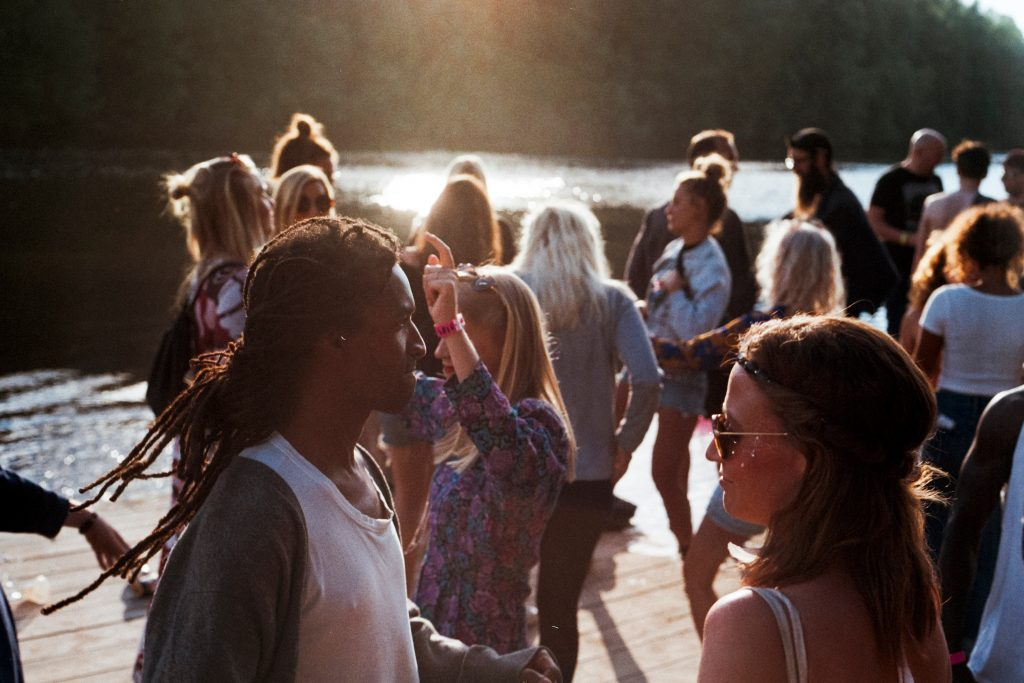 People outside in the sun socialising