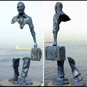 Refugee statue on water